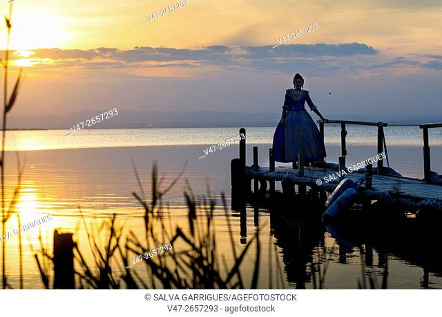 Young woman posing dressed fallera in the Albufera of Valencia, Spain, Europe