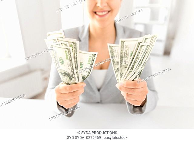 close up of woman hands holding us dollar money