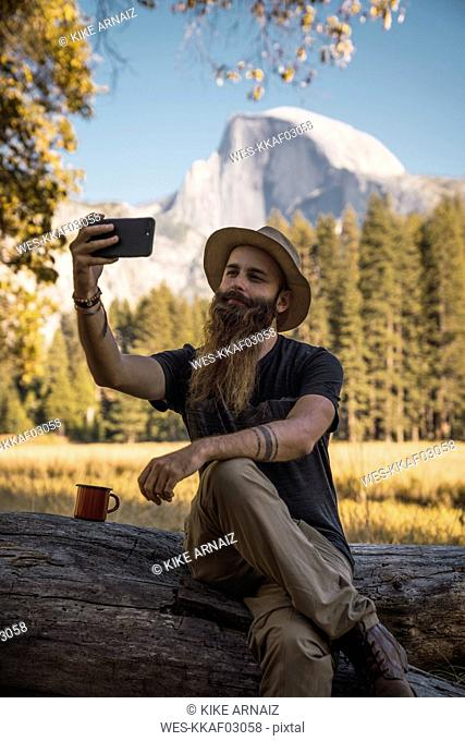 USA, California, bearded man taking a selfie in Yosemite National Park