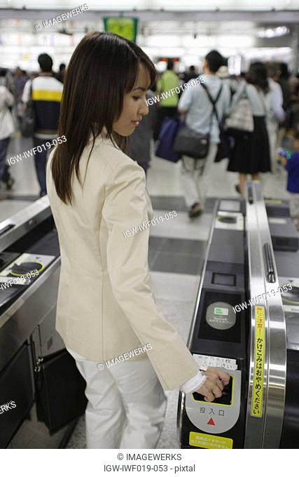 Businesswoman at a railroad station