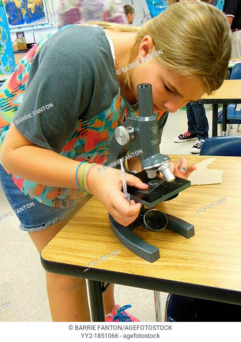 Adjusting Microscope, Science Class, Wellsville, New York