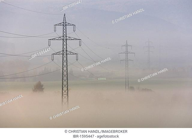 High voltage power line in the morning mist, Berndorf, Triestingtal valley, Lower Austria, Austria, Europe