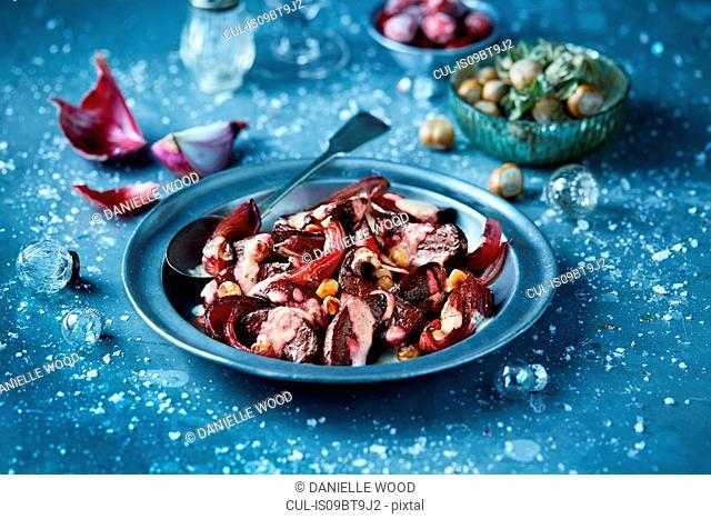 Roasted beetroot in bowl with hazelnut salad, seasonal Christmas food