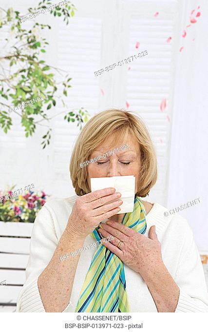 Senior woman sneezing