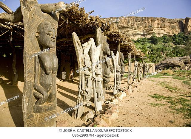 Dogon Country. Mali. Yabatalou village. Deck attached to a house, supported by beautifully carved wooden pillars with dogon iconography