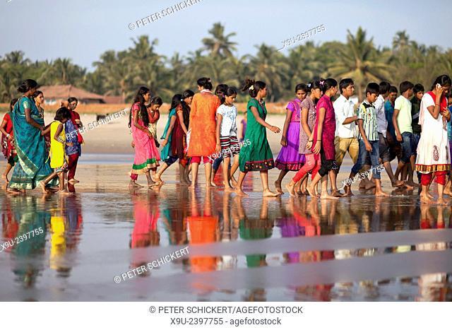 girls in colourful Saris on the City Beach at Gokarna, Karnataka, India, Asia