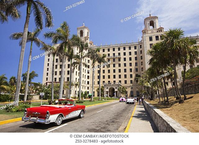 View to the Hotel Nacional in Vedado district with an old American car used as taxi in the foreground, Havana, La Habana, Cuba, West Indies, Central America