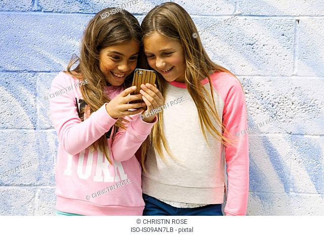 Two girls using smartphone