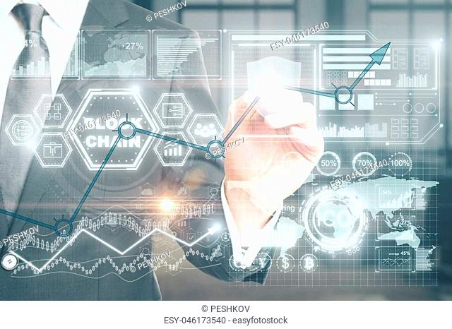 Cryptocurrency, cryptography and e-business concept. Businessman hand with abstract digital hologram on blurry office interior background