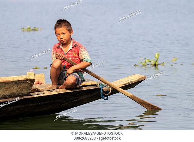 South east Asia, India,Tripura state,Bambur lake,boy on a small boat