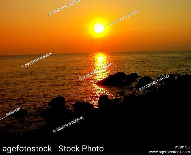 Red Sunset Landscape along with Dark Rocks in Summer