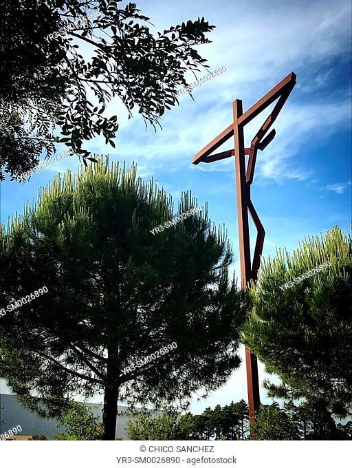 A modern sculpture of Jesus Christ crucified decorates the sanctuary of Our Lady of Rosary in Fatima, Portugal