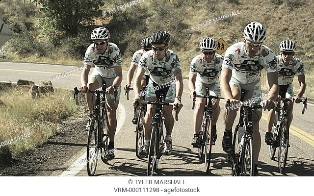 cycling team riding in unison