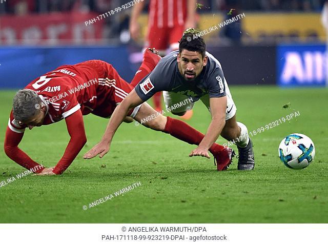 Munich's Robert Lewandowski (L) and Augsburg's Rani Khedira vie for the ball during the Bundesliga soccer match between Bayern Munich and FC Augsburg at the...