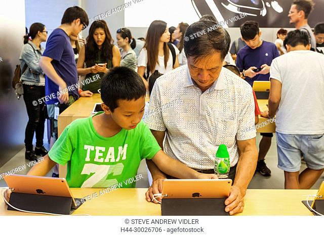 China, Hong Kong, Causeway Bay, Apple Store, Young Boy Teaching Grandfather Computer Skills