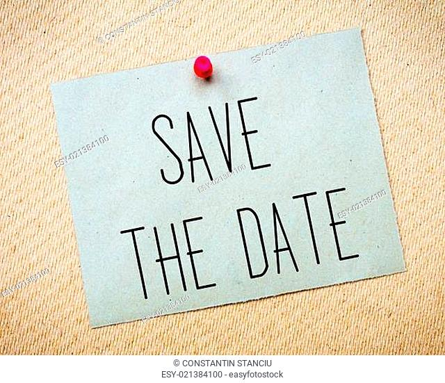 Recycled paper note pinned on cork board.Save the Date Message. Wedding Concept Image