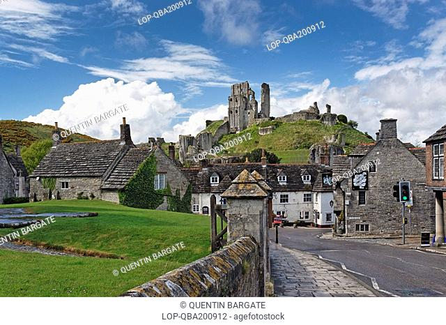 Corfe Castle commanding a gap in the Purbeck Hills overlooking the Bankes Arms Hotel, is now an imposing ruin and a popular tourist centre