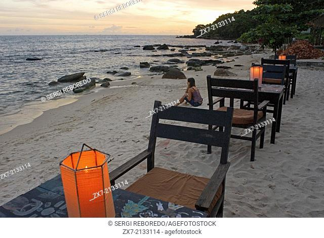 Tables of some of the restaurants on the beach. Sihanoukville beach. Some of these Sihanoukville beaches are crowded with beach chairs, umbrellas, bars