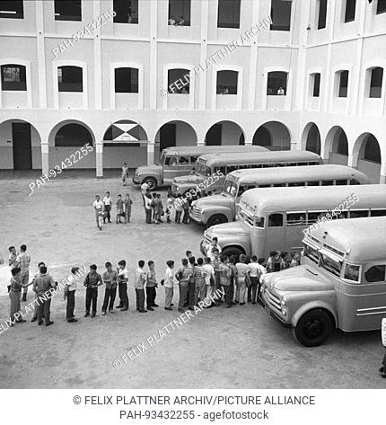 Second courtyard with school buses, Barranquilla (Atlantico), Colombia, 1958.   usage worldwide. - Barranquilla (Atlantico)/Colombia
