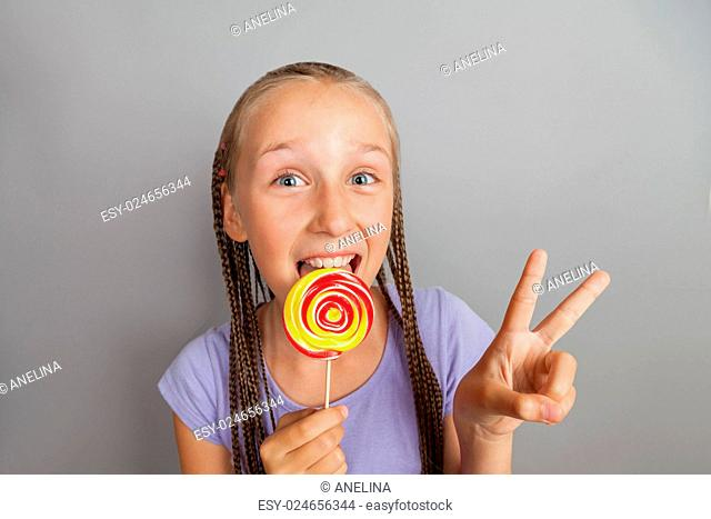 happy girl woman with lollipop