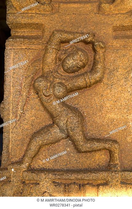 Dancer statue Bas relief in column in Sangeet Mandap , Vittala temple , Hampi , Karnataka , India