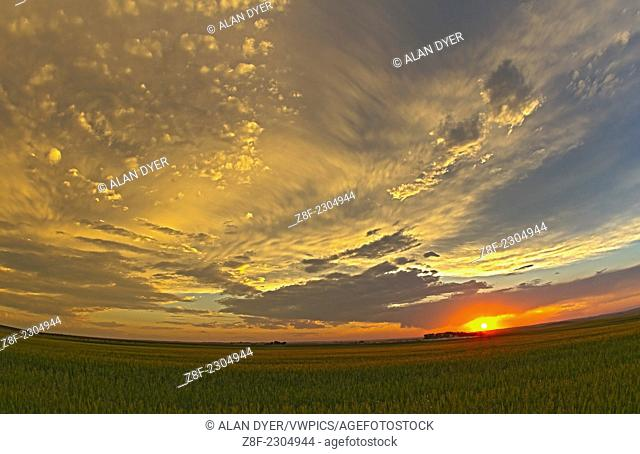 Cloudscape at sunset, July 28, 2010, taken from home with Canon 7D and 15mm lens, grabbed in a hurry and hand-held for a set of 4 exposures for a high-dynamic...