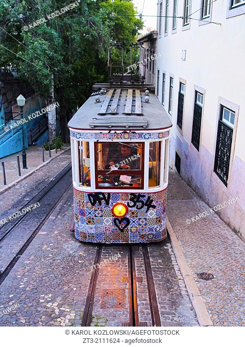 Funicular going up the Calcada da Gloria street in Lisbon, Portugal