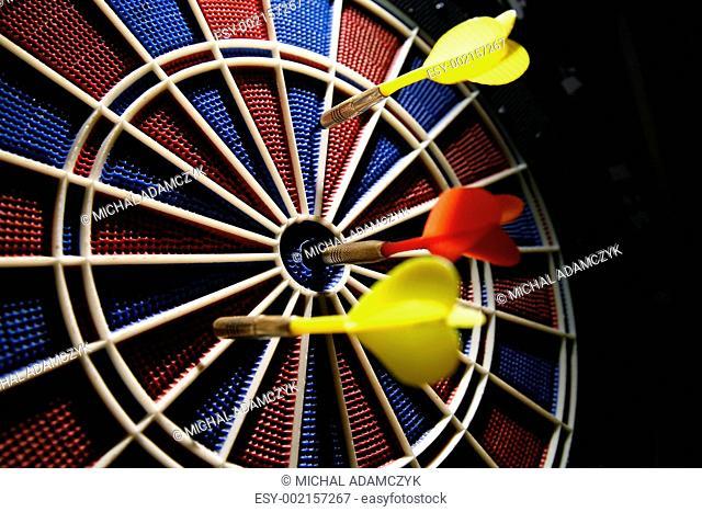 dart boart with three darts