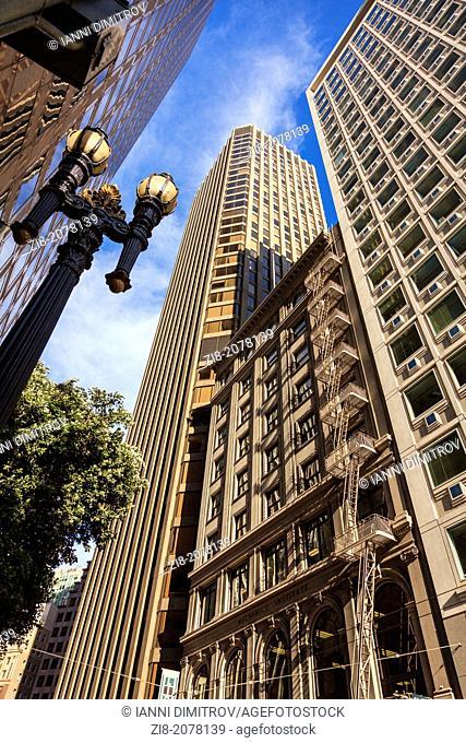 Old building cramped between modern skyscrapers on Kearny Street,San Francisco,California,USA