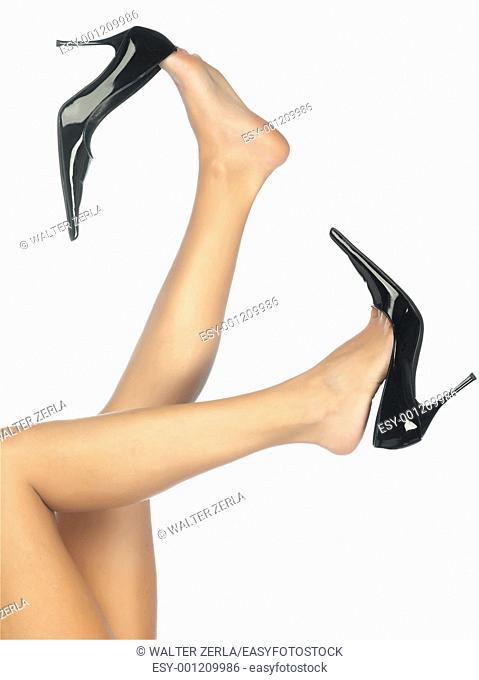 Beautiful legs in black shoes