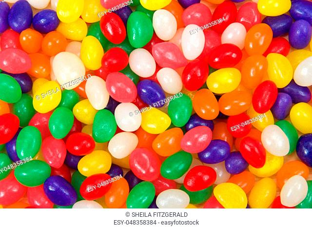 Many brightly colored jelly beans in a rainbow of colors. Popular candy for Easter