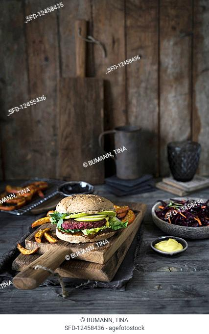 Veggie burger with a beetroot patty and pumpkin fries