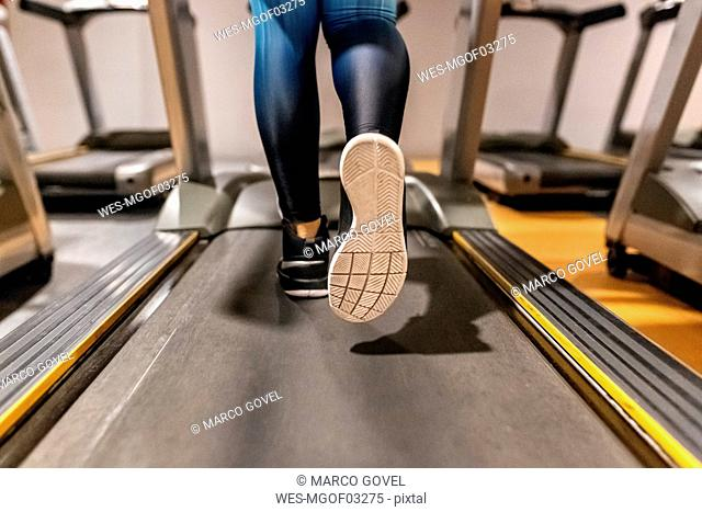 Close-up of woman training in gym on a treadmill