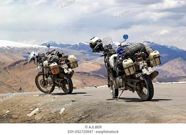 Motorcycles at the Taglang La mountain pass in Ladakh region in the Indian state of Jammu and Kashmir. The mountain pass is an elevation of 5359 metres