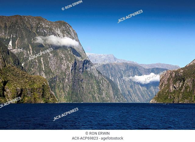 Milford Sound seen from a tour boat coming back into the fjord from the Tasman Sea, Fiordland National Park, New Zealand