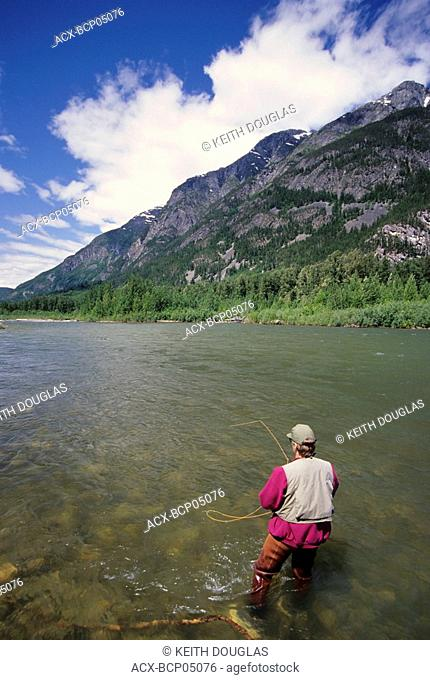 Flyfisherman casting for summer-run steelhead, Dean river, British Columbia, Canada