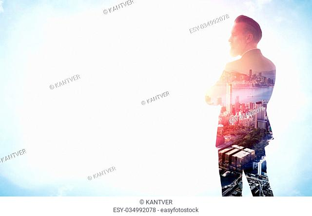 Portrait of stylish businessman. Photo of double exposure of the city. Isolated