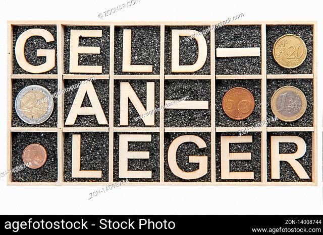 Wooden collecting box with black decorative sand filled single subjects in which the broken german word GELDANLEGER is represented with plywood letters and...