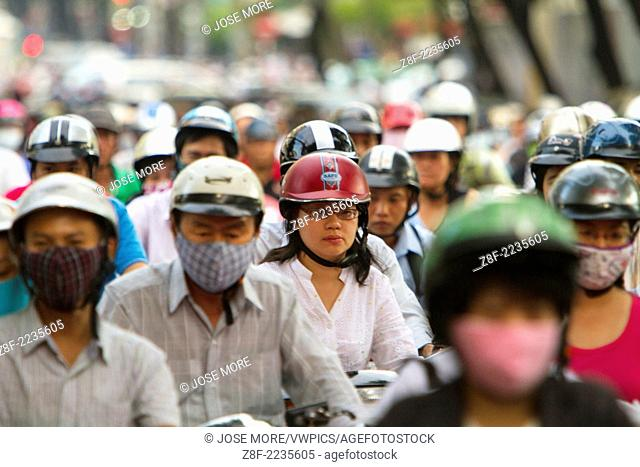 Thousands of motorcycles crowd the streets of Ho Chi Minh City also known as Saigon, the largest city in Vietnam. Inches apart