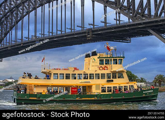 Closeup of Manley public Ferry passing under the Harbour Bridge in Sydney, Australia