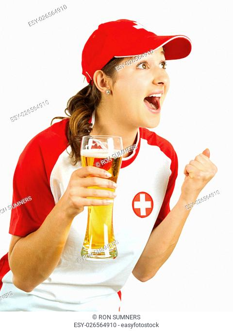 Photo of a Swiss sports fans holding a beer and cheering for her team isolated over white background