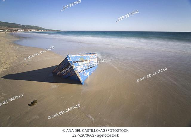 Patera, ruined boat in Bolonia beach in Cadiz province, Andalusia, Spain
