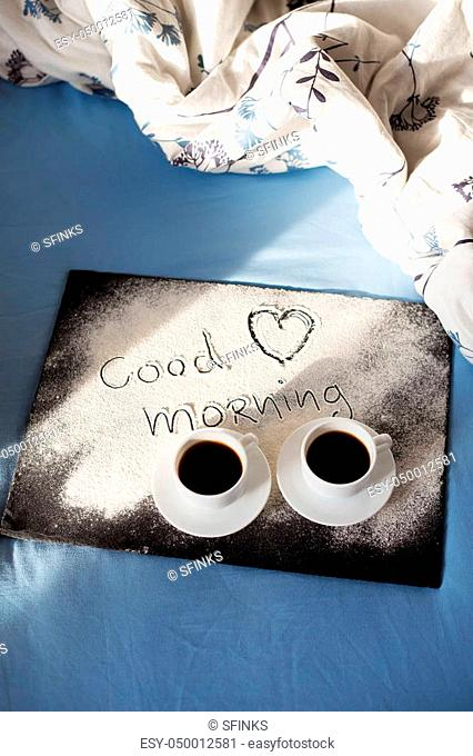 good morning inscription flour on a board with cups of coffee, heart Valentine's day