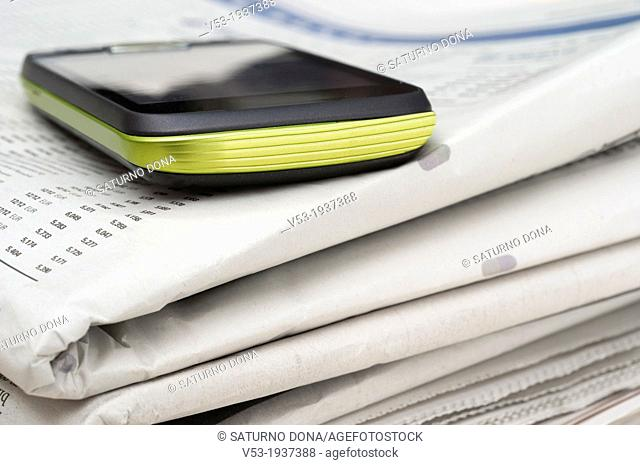 a smartphone on stack of newspapers