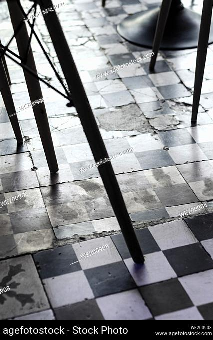 traditional design old rustic floor tiles detail in trendy Ibiza cafe
