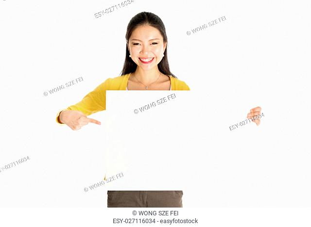 Portrait of casual Asian woman hand holding blank white paper card and pointing on it, isolated on white background