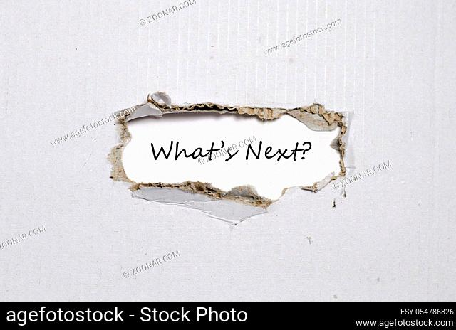 The words what's next appearing behind torn paper