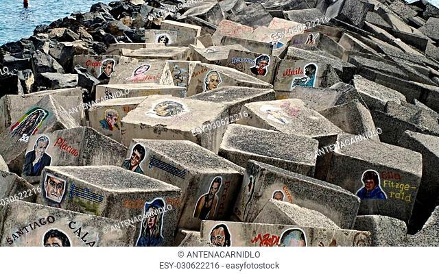 Street-art, grafiti painting of famous singers on concrete blocks