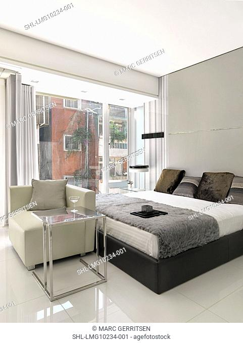 White Bed with brown pillows in modern bedroom