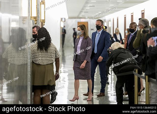 Judge Amy Coney Barrett returns from a lunch break on the third day of her Senate confirmation hearings in the Hart Senate Office Building on Capitol Hill in...
